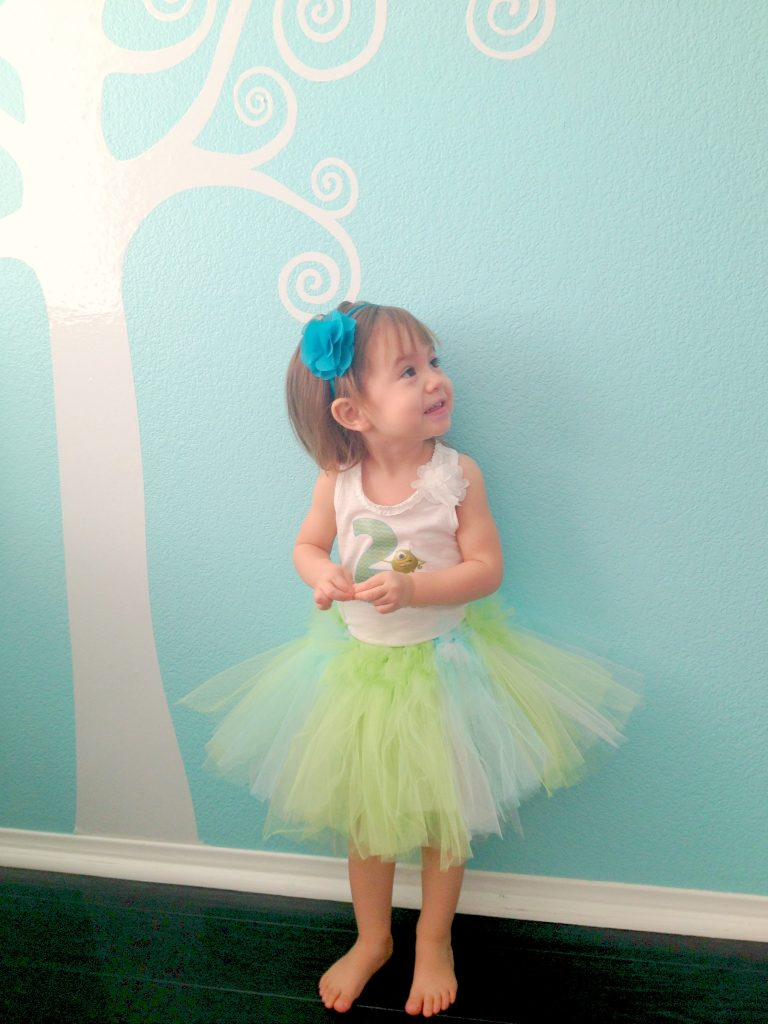 Our Mia Rae of sunshine wearing her Monsters Inc. custom shirt and tutu.
