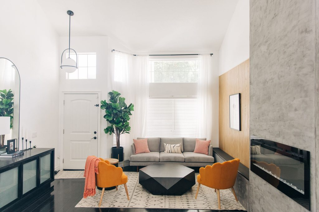 8 Ways to Update Your Living Room-Easy Modern Living Room DIY fireplace - Renovation-Fixer Upper-High-Ceiling-Design-Ideas-mid century-black and white-homegoods